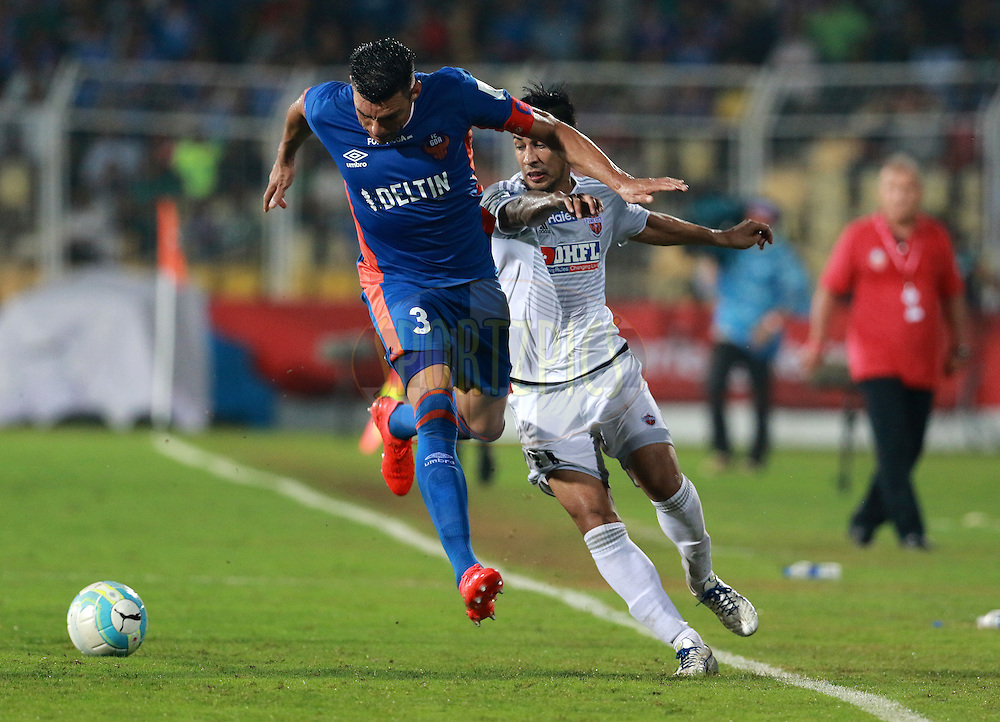 Lucio of FC Goa and Arata Izumi of FC Pune City in action during match 8 of the Indian Super League (ISL) season 3 between FC Goa and FC Pune City held at the Fatorda Stadium in Goa, India on the 8th October 2016.<br /> <br /> Photo by Vipin Pawar / ISL/ SPORTZPICS