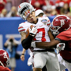 Jan 1, 2015; New Orleans, LA, USA; Alabama Crimson Tide linebacker Reggie Ragland (19) hits Ohio State Buckeyes running back Jalin Marshall (17) knocking his helmet off during the third quarter in the 2015 Sugar Bowl at Mercedes-Benz Superdome. Mandatory Credit: Derick E. Hingle-USA TODAY Sports