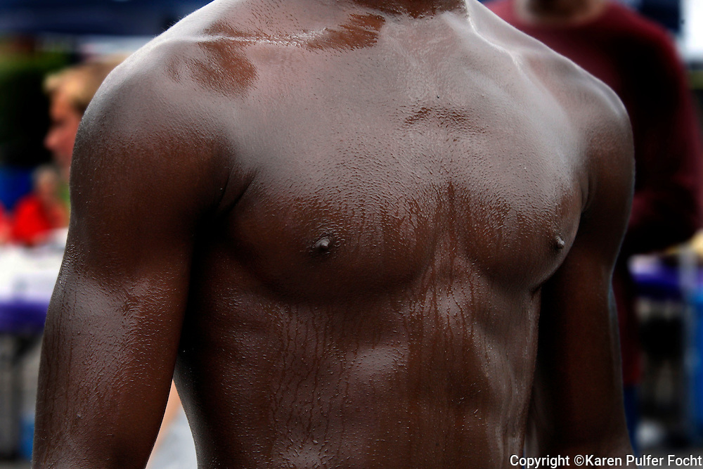 Chest of African American man following a race.