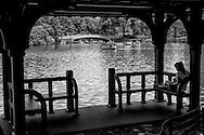 Relaxing in a rustic shelter along The Lake in Central Park.
