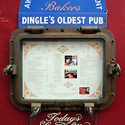 A pub sign in Dingle, County Kerry, Ireland. Dingle is the only town on the Dingle Peninsula. Principal industries in the town are tourism, fishing and agriculture. Dingle, County Kerry, Ireland. Photo Tim Clayton