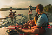 Stand up Paddle Boarding (SUP) on a lake outside Roanoke, Virginia, in the Blue Ridge Mountains.