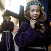 Children penitents carry crosses as they parade during the Maundy Thursday procession on April 17, 2014 in the northern Spanish Basque village of Segura.  PHOTO/ RAFA RIVAS