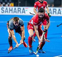 BHUBANESWAR, INDIA - Loick Luypaert (Belgie)  met Thijs van Dam (Ned)  tijdens   de  finale tussen België en Nederland (0-0) bij het WK Hockey heren in het Kalinga Stadion. Belgie wint na shoot-outs. COPYRIGHT KOEN SUYK