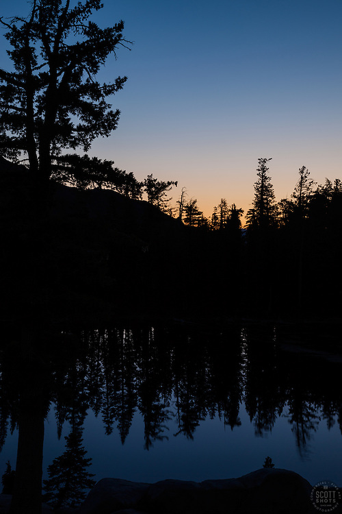 """""""Sunrise at Five Lakes 1"""" - Photograph of a sunrise and reflection of pine trees at Five Lakes, Tahoe."""