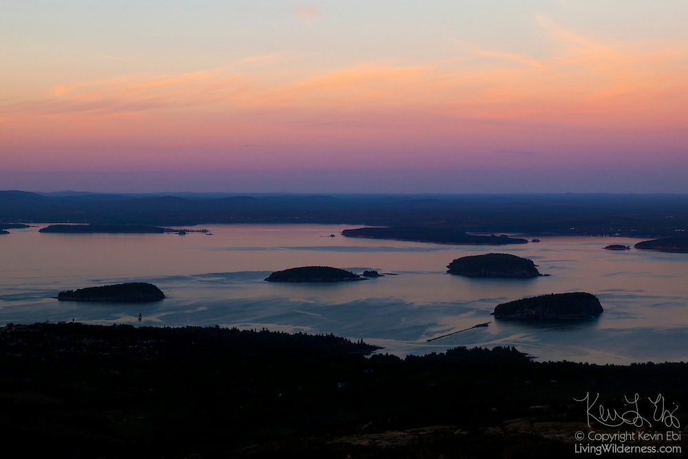 Several of the Porcupine Islands are visible in Bar Harbor, Maine in this view from the summit of Cadillac Mountain. From right to left, the islands are Bald Porcupine Island, Long Porcupine Island, Burnt Porcupine Island (and Rum Key), and Sheep Porcupine Island. Stave Island is also visible along the oppose coast on the right side. Several of the Porcupine Islands have relatively gentle slopes on their north sides and steep drops on the south. Like much of Acadia National Park, they were carved by retreating glaciers.