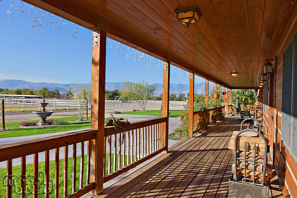 Ranch porch overlooking horse stables
