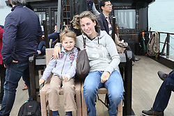 Katharina Offel and son Leo<br /> CSI 5* Longines Hong Kong Masters 2013<br /> Boat trip Hong Kong harbour<br /> © Hippo Foto - Counet Julien