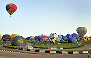 London News pictures. 07/04/2011. CANTERBURY: Approximately 50 hot air balloons from across the UK and Europe take off from Lydden Hill Race Circuit, Wootton, Kent to fly across the English Channel marking the largest ever group of balloons to attempt the crossing.. Picture credit should read Stephen Simpson/LNP
