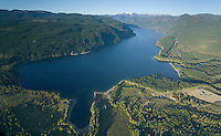 An aerial view of comox lake, the comox glacier and surrounding mountains.  Comox Valley, Vancouver Island, British Columbia, Canada.