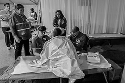 Members of the medical team treat a runner in the finish line medical tent.