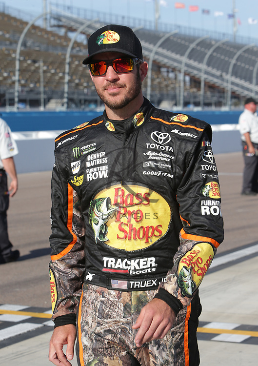 Martin Truex Jr. qualifies for Sunday's NASCAR Cup Series auto race on Friday, March 17, 2017, in Avondale, Ariz.  (AP Photo/Rick Scuteri)