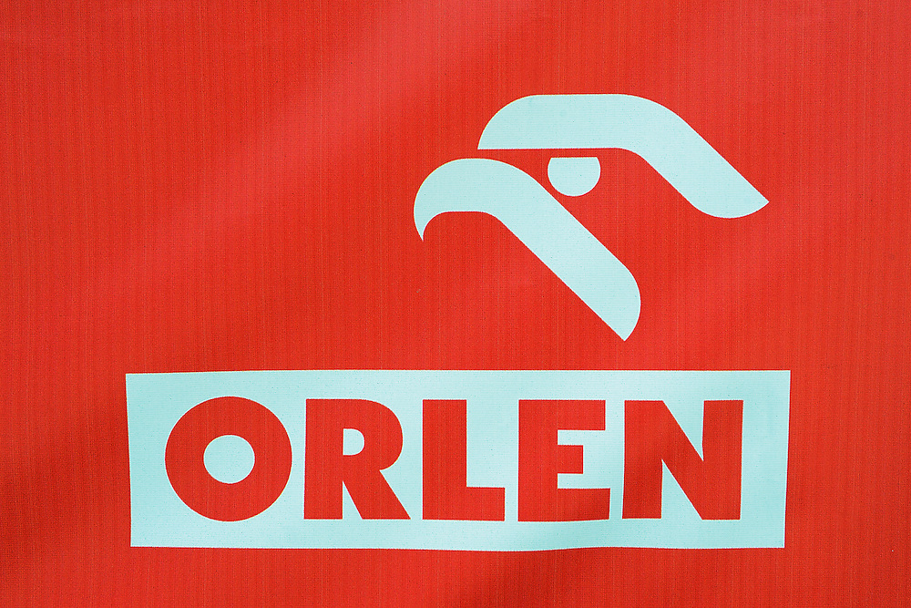 "Polish gas station chain ""Orlen"", with eagle/falcon as their symbol, Goleniow, Poland, Oder river delta/Odra river rewilding area, Stettiner Haff, on the border between Germany and Poland"