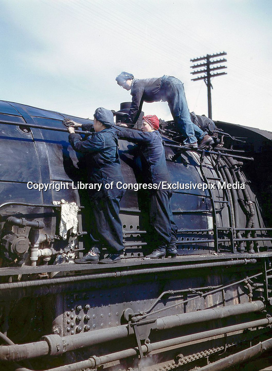 """Fascinating Color Portrait Photos of Women Railroad Workers During WWII<br /> <br /> World War II began when Hitler's army invaded Poland on September 1, 1939. However, it wasn't until the day after the Japanese attacked Pearl Harbor on December 7, 1941, that the United States declared war on the Axis Powers.<br /> <br /> The railroads immediately were called upon to transport troops and equipment heading overseas. Soon the efforts increased to supporting war efforts on two fronts-- in Europe and in the Pacific.<br /> <br /> Prior to the 1940s, the few women employed by the railroads were either advertising models, or were responsible primarily for cleaning and clerical work. Thanks to the war, the number of female railroad employees rose rapidly. By 1945, some 116,000 women were working on railroads. A report that appeared on the 1943 pages of Click Magazine regarding the large number of American women who had stepped forward to see to it that the American railroads continued to deliver the goods during the Second World War:<br /> <br />     """"Nearly 100,000 women, from messengers aged 16 to seasoned railroaders of 55 to 65, are keeping America's wartime trains rolling. So well do they handle their jobs that the railroad companies, once opposed to hiring any women, are adding others as fast as they can get them...""""<br /> <br /> In April 1943, Office of War Information photographer Jack Delano photographed the women of the Chicago & North Western Railroad roundhouse in Clinton, Iowa, as they kept the hulking engines cleaned, lubricated and ready to support the war effort.<br /> <br /> Photo shows: Wipers clean an H-class locomotive.<br /> ©Library of Congress/Exclusivepix Media"""