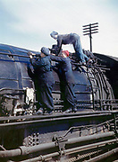 Fascinating Color Portrait Photos of Women Railroad Workers During WWII<br /> <br /> World War II began when Hitler's army invaded Poland on September 1, 1939. However, it wasn't until the day after the Japanese attacked Pearl Harbor on December 7, 1941, that the United States declared war on the Axis Powers.<br /> <br /> The railroads immediately were called upon to transport troops and equipment heading overseas. Soon the efforts increased to supporting war efforts on two fronts-- in Europe and in the Pacific.<br /> <br /> Prior to the 1940s, the few women employed by the railroads were either advertising models, or were responsible primarily for cleaning and clerical work. Thanks to the war, the number of female railroad employees rose rapidly. By 1945, some 116,000 women were working on railroads. A report that appeared on the 1943 pages of Click Magazine regarding the large number of American women who had stepped forward to see to it that the American railroads continued to deliver the goods during the Second World War:<br /> <br />     &quot;Nearly 100,000 women, from messengers aged 16 to seasoned railroaders of 55 to 65, are keeping America's wartime trains rolling. So well do they handle their jobs that the railroad companies, once opposed to hiring any women, are adding others as fast as they can get them...&quot;<br /> <br /> In April 1943, Office of War Information photographer Jack Delano photographed the women of the Chicago &amp; North Western Railroad roundhouse in Clinton, Iowa, as they kept the hulking engines cleaned, lubricated and ready to support the war effort.<br /> <br /> Photo shows: Wipers clean an H-class locomotive.<br /> &copy;Library of Congress/Exclusivepix Media