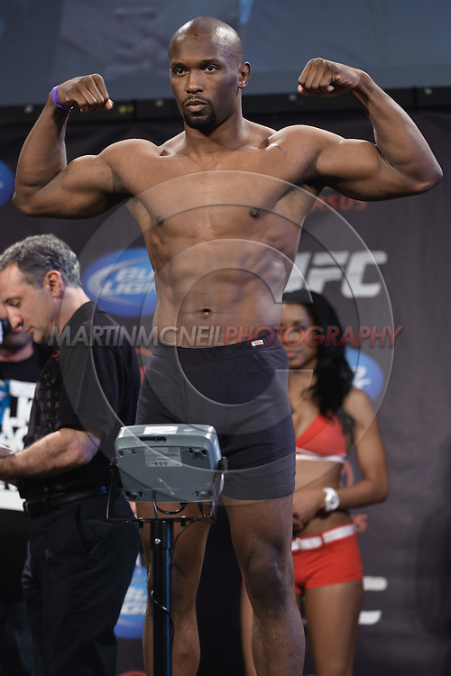 "PITTSBURGH, PENNSYLVANiA, JUNE 25, 2011: Daniel Roberts poses on the scales during the official weigh-in for ""UFC on Versus 4: Kongo vs. Barry"" inside Heinz Field Cocz Cola Great Hall in Pittsburgh, Pennsylvania on June 25, 2011."