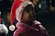Young girl smiling at the mum after having bought her a Santa Claus cap at one of the numerous stalls on Oxford Street during Christmas time, on Wednesday, Dec. 22, 2004.  **ITALY OUT**