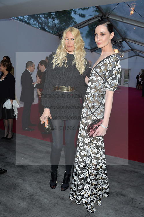 Left to right, CLAUDIA SCHIFFER and ERIN O'CONNOR at British Vogue's Centenary Gala Dinner in Kensington Gardens, London on 23rd May 2016.