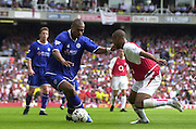 Premiership Football - Arsenal v Leicester City:.2003/04 Season - 15/05/2004  [Record breaking Season undefeated] .Leicester's Marcus Bent, looks to go round Arsenal's Ashly Cole. .[Credit] Peter Spurrier Intersport Images