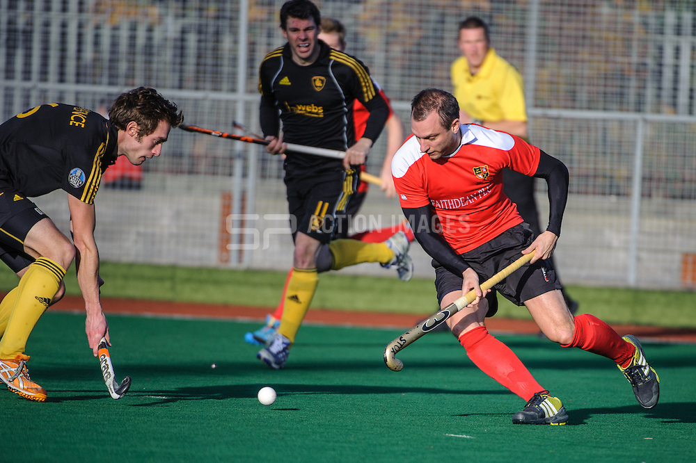 Danny Hall of Holcombe tries to beat Stephen Lawrence of Beeston in the England Hockey Men's Cup