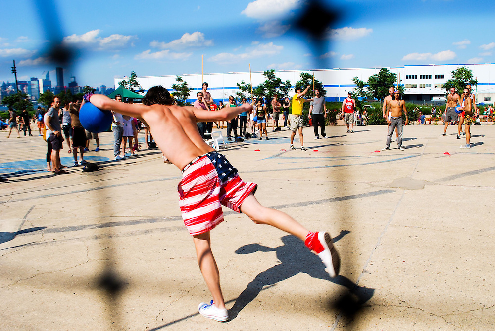 Dodgeballer in USA flag trunks at the JELLY Pool Party free concert series at East River State Park, Williamsburg, Brooklyn, New York