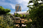 Morning view through trees. The City of Wine, Bordeaux, France. Architect: XTU Architects, 2016.
