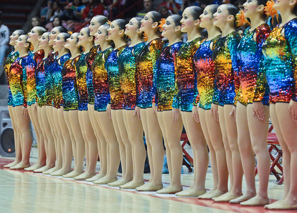mkb032517/metro/Marla Brose --  Roswell High's dance team, takes the floor before performing their Class 5A first place routine during the State Spirit Championships at The Pit in Albuquerque, N.M., Saturday, March 25, 2017. (Marla Brose/Albuquerque Journal)