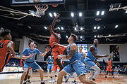 Cal State Fullerton Titans guard Brandon Kamga (1) attempts a layup against San Diego Toreros forward Alex Floresca (15) and guard Finn Sullivan (5) during an NCAA basketball game, Wednesday, Dec. 11, 2019, in Fullerton, Calif. San Diego defeated CSUF 66-54. (Jon Endow/Image of Sport)