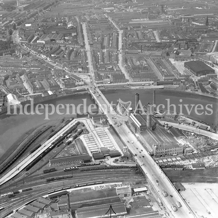 A53 Belfast.   (N.D.) (Part of the Independent Newspapers Ireland/NLI collection.)<br /> <br /> <br /> These aerial views of Ireland from the Morgan Collection were taken during the mid-1950's, comprising medium and low altitude black-and-white birds-eye views of places and events, many of which were commissioned by clients. From 1951 to 1958 a different aerial picture was published each Friday in the Irish Independent in a series called, 'Views from the Air'.<br /> The photographer was Alexander 'Monkey' Campbell Morgan (1919-1958). Born in London and part of the Royal Artillery Air Corps, on leaving the army he started Aerophotos in Ireland. He was killed when, on business, his plane crashed flying from Shannon.