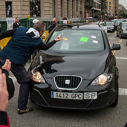 A protestor shows his frustration with a taxi driver who is working and not joining the general strike held in Barcelona on November 14, 2012.