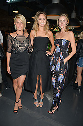 Left to right, ASHLEY ROBERTS, SUKI WATERHOUSE and DONNA AIR at a party to launch the Amazon Fashion Photography Studio at 383 Geffrye Street, London E2 on 23rd July 2015.