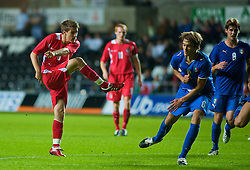 SWANSEA, ENGLAND - Friday, September 4, 2009: Wales' Aaron Ramsey scores the winning goal with a wonder strike to seal a 2-1 victory over Italy during the UEFA Under 21 Championship Qualifying Group 3 match at the Liberty Stadium. (Photo by Gareth Davies/Propaganda)