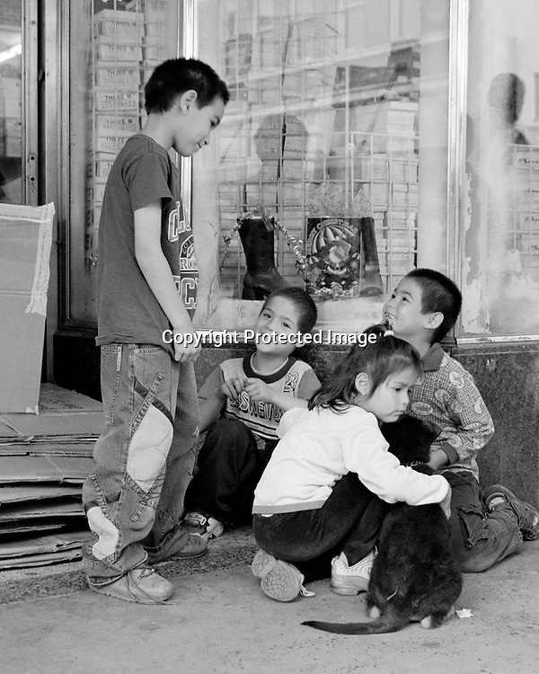"""Kids at play with a dog on the streets of old downtown Laredo, Texas. NOTE: Click """"Shopping Cart"""" icon for available sizes and prices. If a """"Purchase this image"""" screen opens, click arrow on it. Doing so does not constitute making a purchase. To purchase, additional steps are required."""