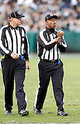 An NFL official calls holding during the Oakland Raiders NFL week 16 football game against the Indianapolis Colts on Sunday, December 26, 2010 in Oakland, California. The Colts won the game 31-26. (©Paul Anthony Spinelli)