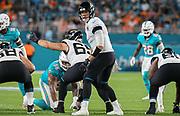 Aug 22, 2019; Miami Gardens, FL USA;  Jacksonville Jaguars quarterback Nick Foles (7) prepares to receive the snap from center Brandon Linder (65) during an NFL preseason game at Hard Rock Stadium. The Dolphins beat the Jaguars 22-7. (Kim Hukari/Image of Sport)