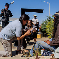 """Writer director Shaandiin Tome, center, works with actors Murphy Zoel Zohnnie, right, and Trini King on the set of Tome's film """"Mud"""" in Gallup Monday."""