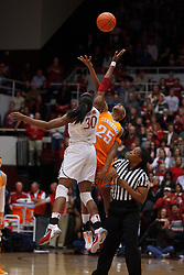 Dec 20, 2011; Stanford CA, USA;  Stanford Cardinal forward Nnemkadi Ogwumike (30) and Tennessee Lady Volunteers forward Glory Johnson (25) reach for the opening tip off during the first half at Maples Pavilion.  Mandatory Credit: Jason O. Watson-US PRESSWIRE