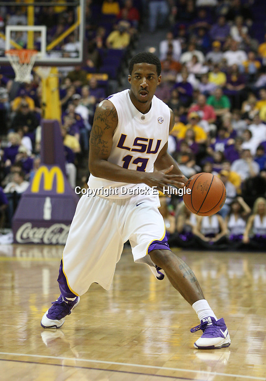 14 February 2009: LSU guard Terry Martin (13) handles the ball during a NCAA basketball game between SEC rivals the Ole Miss Rebels and the LSU Tigers at the Pete Maravich Assembly Center in Baton Rouge, LA.
