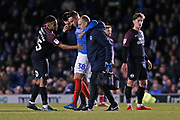 Brandon Haunstrup goes off injured during the EFL Sky Bet League 1 match between Portsmouth and Peterborough United at Fratton Park, Portsmouth, England on 7 December 2019.