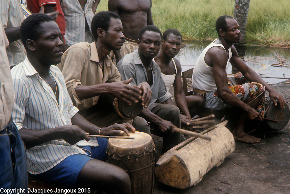 Africa, Democratic Republic of the Congo, Ngiri River area, Libinza tribe. Men playing drums.