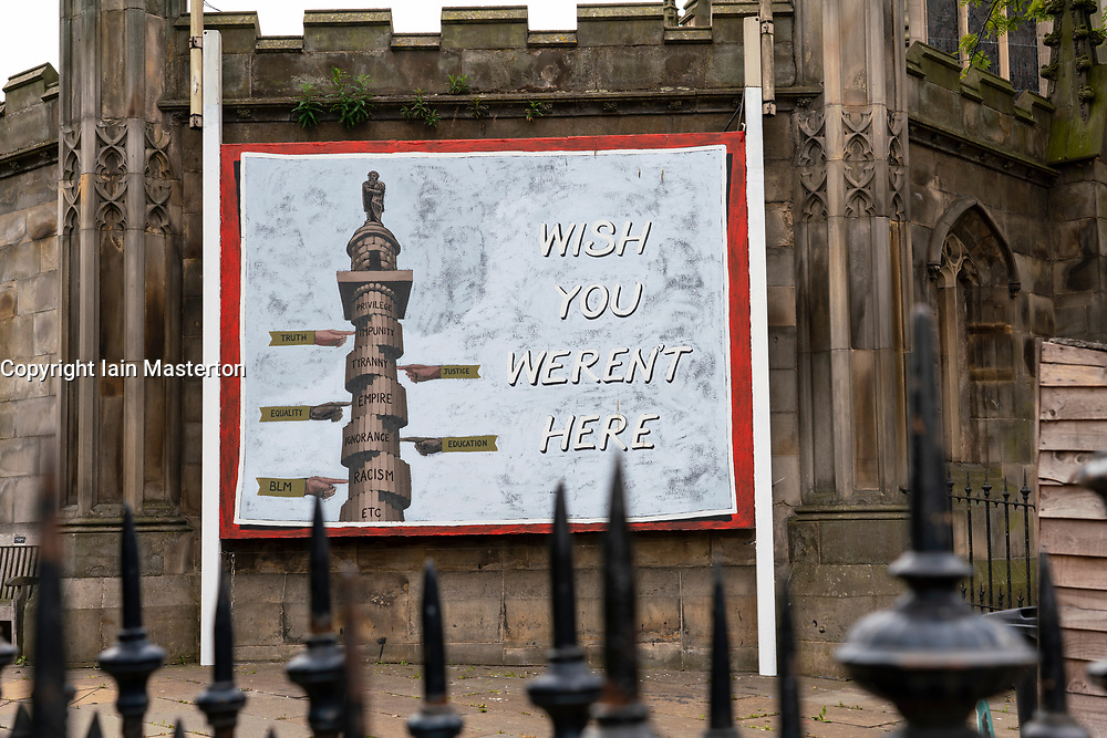 "Edinburgh, Scotland, UK. 17 June, 2020. Views from Edinburgh city centre before expected relaxation of covid-19 lockdown by Scottish Government. Pictured; A billboard poster with a picture of the Melville Monument with the caption ""Wish You Weren't Here"" has appeared outside St John's Church on Princes Street. Iain Masterton/Alamy Live News"