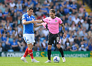 Portsmouth midfielder Gary Roberts and Northampton Town Midfielder Ricky Holmes during the Sky Bet League 2 match between Portsmouth and Northampton Town at Fratton Park, Portsmouth, England on 7 May 2016. Photo by Adam Rivers.
