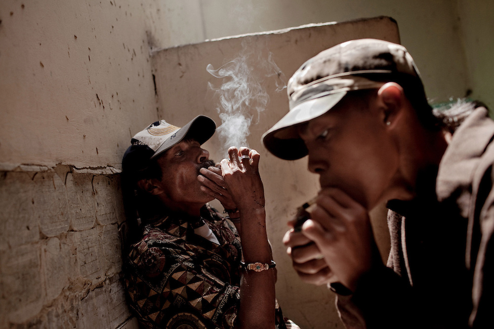 A gang member from Mara Salvatrucha known as Jose Miel, right,18, smokes crack with friends in an abandoned house in Tegucigalpa, Honduras. March 12, 2011.  He was abandoned by his parents when he was a young boy, he is addict to crack since he was 13, and now lives with the gang and deal with drugs. Photo/Tomas Munita  ***IMPORTANT - DONT PUBLISH IN HONDURAS***
