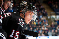 KELOWNA, CANADA -FEBRUARY 5:  Cole Chorney C #15 of the Red Deer Rebels stands on the bench during a time out against the Kelowna Rockets on February 5, 2014 at Prospera Place in Kelowna, British Columbia, Canada.   (Photo by Marissa Baecker/Getty Images)  *** Local Caption *** Cole Chorney;