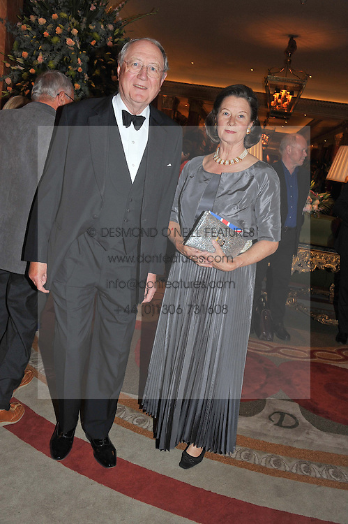 BRUNO SCHRODER and BARONESS SUZANNE MALTZAHN at Fashion For The Brave held at The Dorchester Hotel, Park Lane, London on 20th September 2012.