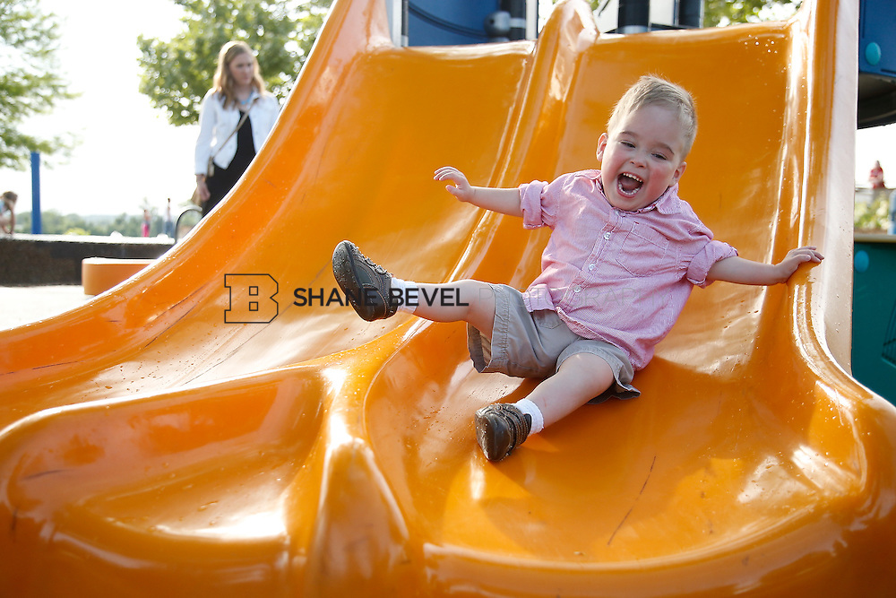 5/28/15 6:06:40 PM -- Miracle Miles and his family pose for portraits and play at the QuikTrip park for the 2015 Saint Francis Health System advertising campaign. <br /> <br /> Photo by Shane Bevel