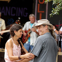 Anne Shrago, left, and Ben Comfort dance to music Sunday July 27, 2014 during the All-Day Blues Jam at The Rusty Nail in Wilmington, N.C. The event was part of the 19th Annual Cape Fear Blues Festival. (Jason A. Frizzelle)