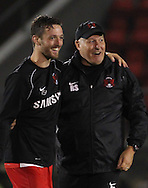 Picture by David Horn/Focus Images Ltd +44 7545 970036<br /> 17/09/2013<br /> Russell Slade Manager of Leyton Orient celebrates a win with David Mooney after the Sky Bet League 1 match at the Matchroom Stadium, London.