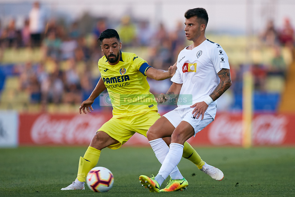 July 17, 2018 - Villareal, Castellon, Spain - Jaume Costa (L) of Villarreal CF competes for the ball with Pol Roige of Hercules CF during the Pre-Season Friendly match between Villarreal CF and Hercules CF at Mini Estadi on July 17, 2018 in Vila-real, Spain  (Credit Image: © David Aliaga/NurPhoto via ZUMA Press)