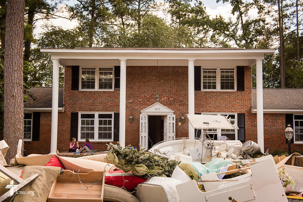 Homeowners pile flood-damaged debris in front of homes on Thursday, Oct. 8, 2015, in Columbia, S.C. LCMS Communications/Erik M. Lunsford